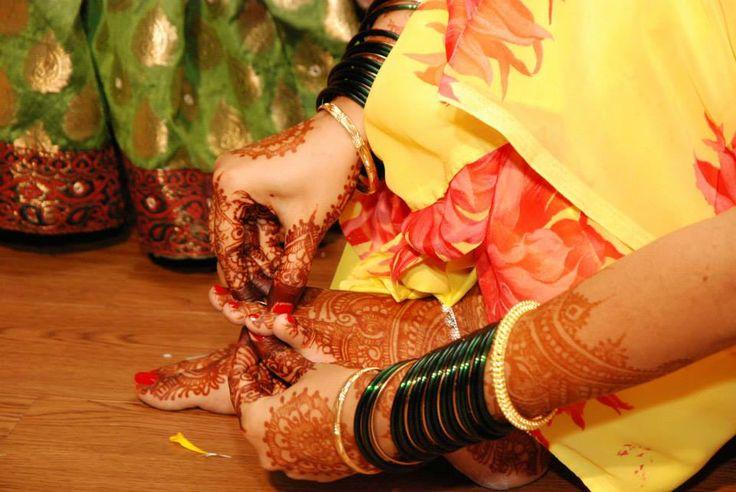 indian bride mehndi and green bangles