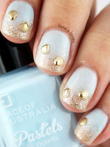 To recreate a similar beach-inspired style like these from Lissa's Love, first paint your nails a shade of light blue. Then, dab gold glitter on the tips of your nails to mimic the sand.