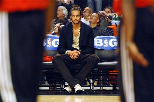 Joakim Noah with a sense of style?  Blazers coming back and pair it with a vneck!
