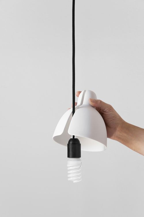 Venice is a porcelain lampshade that quickly turns a simple ceiling light point into a luminaire. Just secure the small safety part onto the wire by adjusting the set screw and place the lampshade over it. This way you will enjoy warm, diffuse light anywhere in your home. http://www.adolfoabejon.com/#/venice/