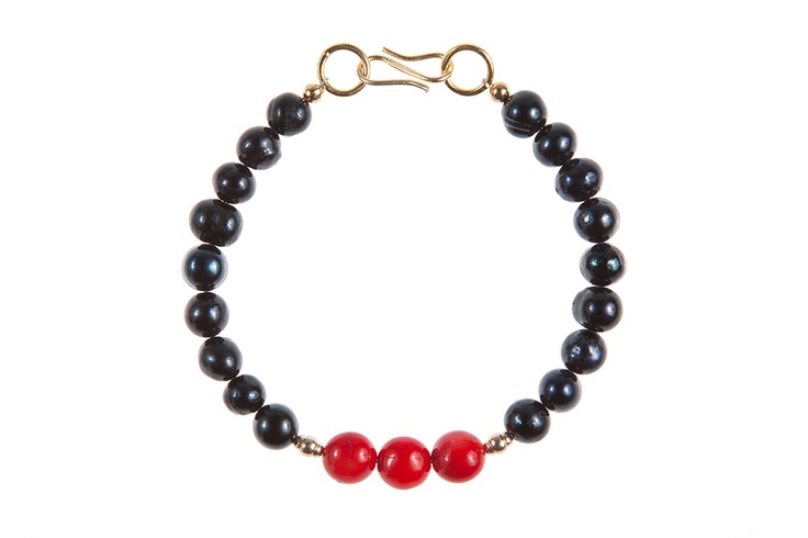Lady Magpie - Romanian designer  Made of: red coral, cultured pearls, gold-filled beads, golden accessories.