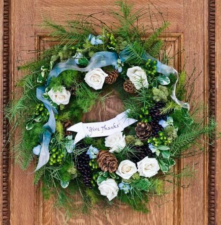 "A ""Give Thanks"" wreath sets a welcoming tone at your front door. Details + more Thanksgiving decorating ideas: http://www.midwestliving.com/holidays/thanksgiving/easy-ideas-for-thanksgiving-decorating/?page=2,0"