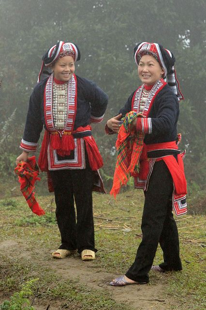 Festivities in traditional dress of a Red Dao wedding (Northern Vietnam).  The Dao (pronounced Zao) are the 9th largest ethnic group in Vietnam with a population of just under 500,000. They belong to the Hmong Dao language group and are believed to have started migrating from China in the 13th century. The women wear some of the most colourful and diverse costumes of all ethnic groups but can be identified by their black trousers richly embroidered with flower or small s.