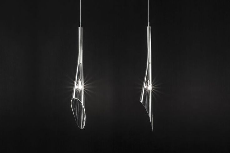 2013 | TERZANI | CALLE | Calle pendant light collection merges Terzani decorative approach, with a refined, clean and pure design. The inverted flute of crystal, like the calla lily it mimics, can be grouped into stunning and always different bouquets of light.