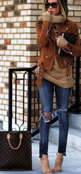 brown suede biker jacket, beige pullover with a wide turtleneck, dark blue tight jeans with destroyed effects, light beige leather heeled sandals for …