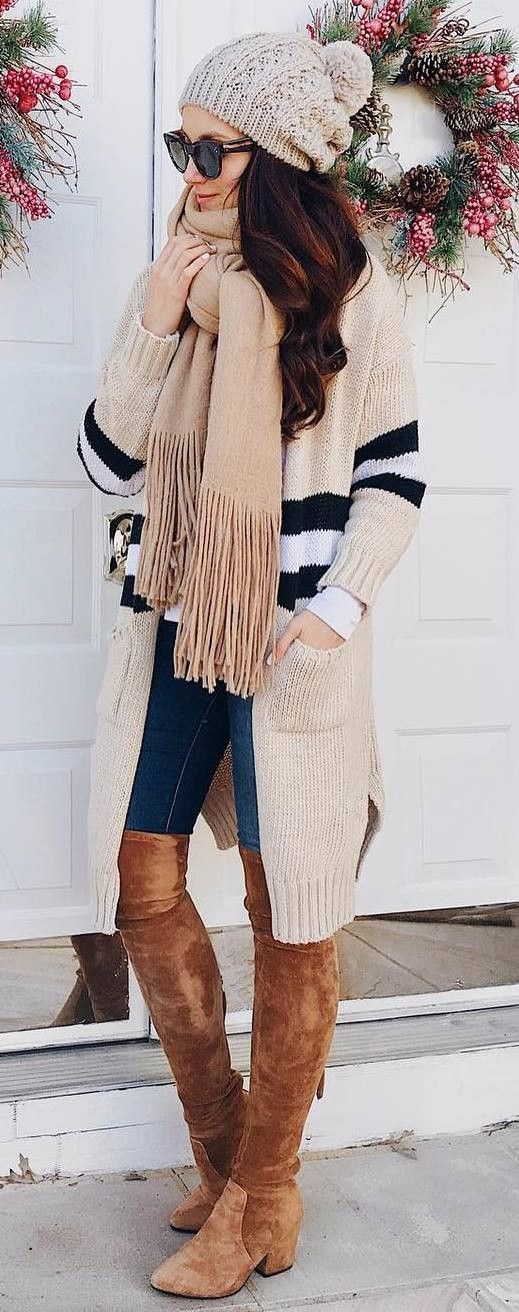 cozy winter outfit idea : hat   nude scarf   stripped cardi   skinnies   brown over knee boots