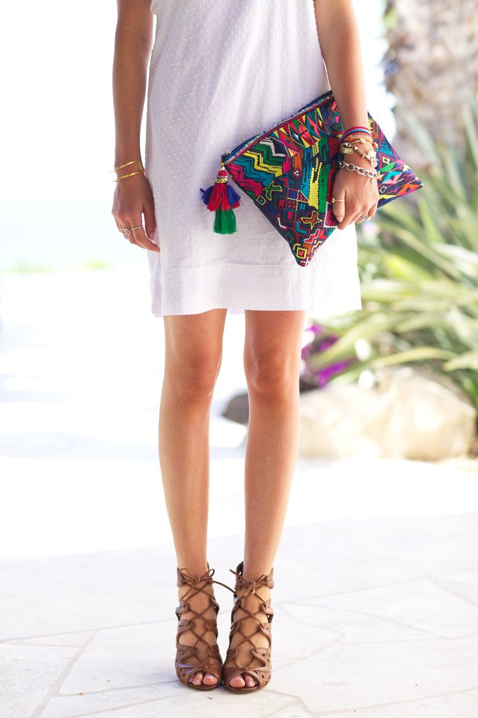 Lace up heels and colorful clutch
