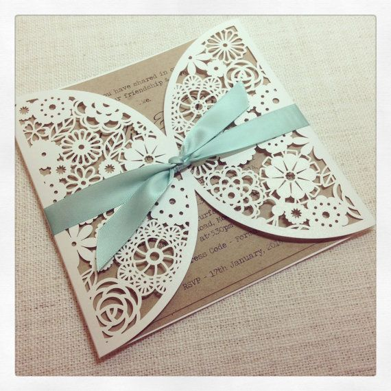 This is a listing for a Sample Rustic Mint Lasercut wedding invitation - the invitation has a lovely floral paper lace laser cut outer pocket