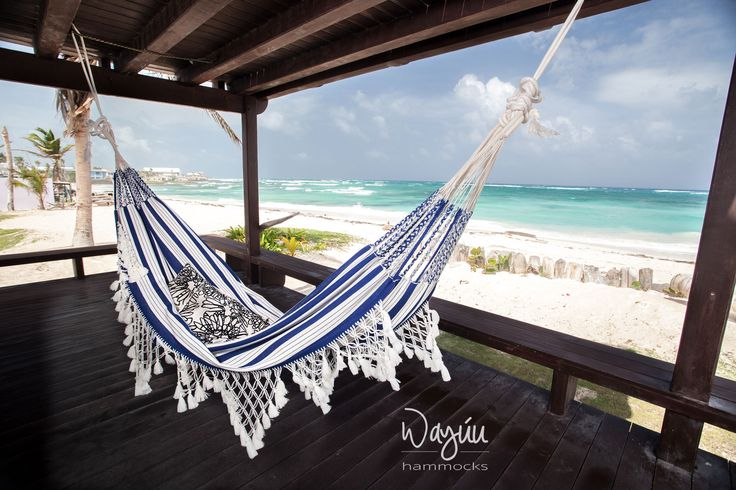 Lie down, kick off your shoes, and rest in the luxury and comfort of your sharp off-white and vivid blue hammock from Sucre, in Northern Colombia.  This hammock takes three weeks to craft. Invest in the people of Sucre and a generation of proud crafters and designers. Your hammock is a symbolic piece of art, created with love and attention, and will last a lifetime.