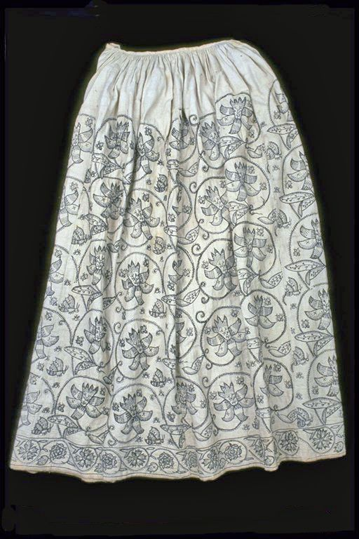 Skirt  A rare woman's skirt made from fustian, a mix of linen and cotton, and embroidered with large floral patterns.  1621-1640  ID no:  59.77b