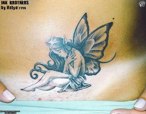 Wow...Fairy Tattoo..great details                                                                                                                                                     More