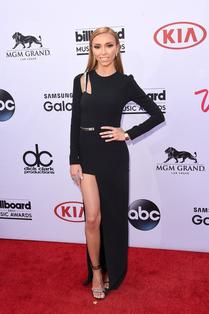 Pin for Later: See Every Stunning Look From Last Year's Billboard Music Awards Giuliana Rancic The host showed off a whole lot of leg in a sleek back dress that featured some silver embellishments.
