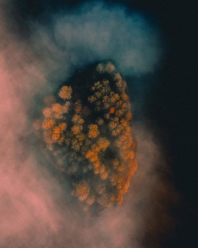 Drone photograph of an island in the fog. Available as poster and laminated picture at Printler, the marketplace for photo art.