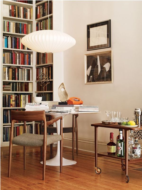 Amazing George Nelson Saucer Lamp, but we're also swooning over those Danish style armchairs and wooden bar cart!