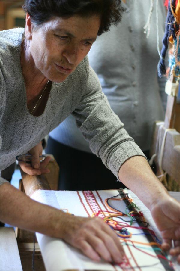 Olga showing the weaving process