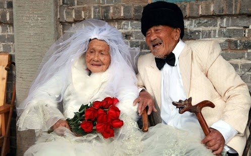 A centenarian couple who have been married for 88 years have finally had their wedding photos taken. Wu Conghan, 101, and his wife Wu Sognshi, 103, married in 1924, and have been together for almost nine decades. When they got married there wasn't the option to have photos taken and it is something they have dreamt of having ever since. Recently their dream was made reality by a local photo company in Nanchong, Sichuan Province, China, and the pair posed in their wedding finery for the shots