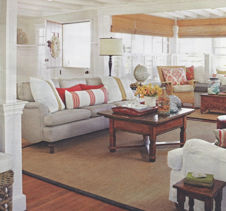 love the shades, the red accents and the taupe couches