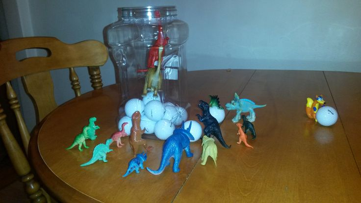 November 4, 2014: The dinosaurs found daddy's golf balls - the ones my boy is constantly tempted to throw around the house - and two resourceful dinos climbed in the container, trying to get the balls out. Swiper (from Dora, my boy's favourite) got in on the action and is trying to swipe one of the balls.