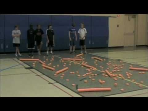 Mine Field - YouTube  Your partner leads you, blinfolded, through a pool noodle/pool noodle rings mine field!  Great for communication!
