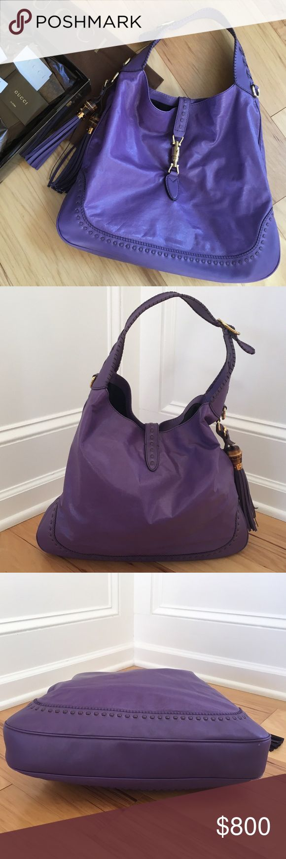 Gucci 'New Jackie' size Large, deep purple leather 100% authentic Gucci 'New Jackie Large' in deep purple leather. Removable shoulder strap. Closes with a lock on the front. Lined in black monogram nylon with a cell phone pocket agains the front and a zipper pocket against the back. Excellent condition. Comes with box, dust bag, cards, receipt and strap. Purchased from Gucci $1981. It's a beautiful large unused bag in my closet  Width : 43cm (16.8in) Height : 34cm (13.3in) Depth : 6cm…