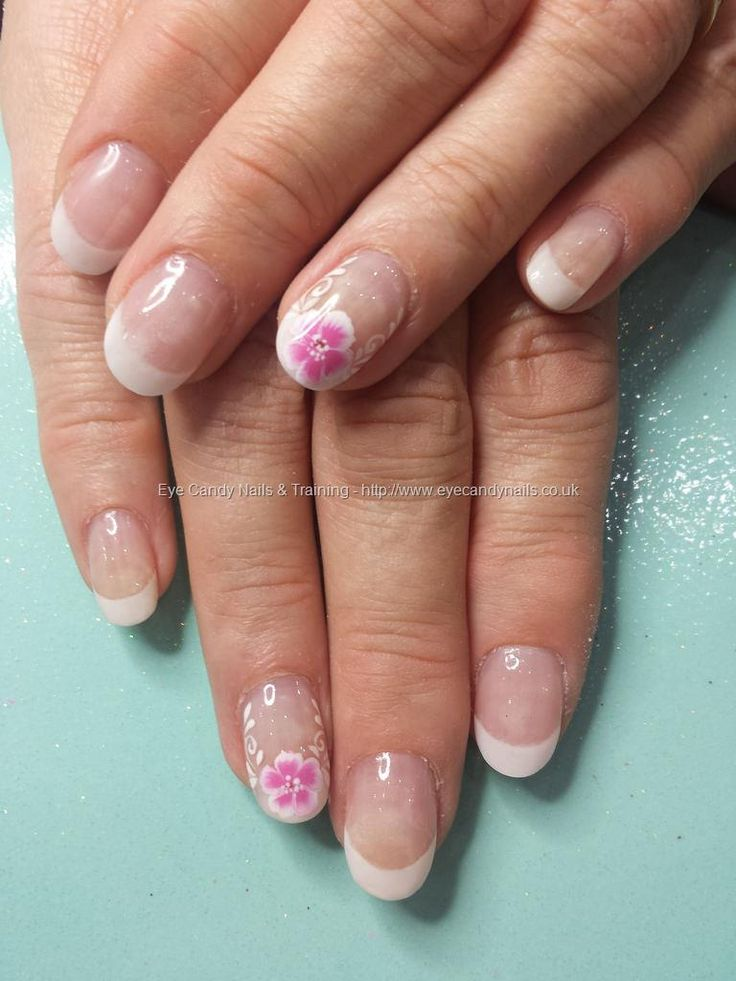 Whute french acrylic tips with freehand flower nail art