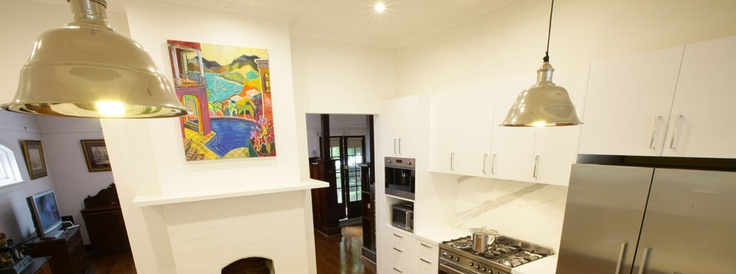 Industrial light fixtures and marble splash back in a kitchen renovation, Balwyn, Melbourne.