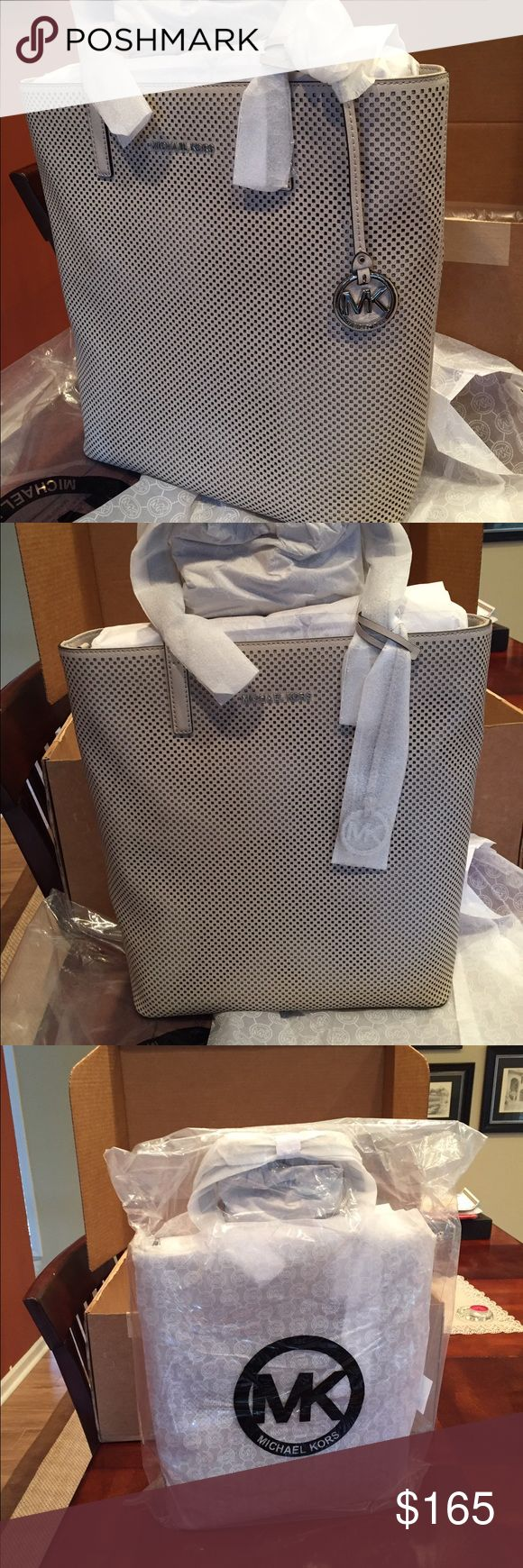 brand new still in box this large michael kors tote is still all wrapped up and