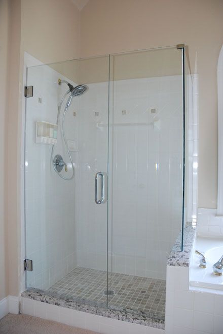 Frameless Shower Doors Matched With White Ceramics Wall Plus Silver Shower  Faucet For Bathroom Ideas