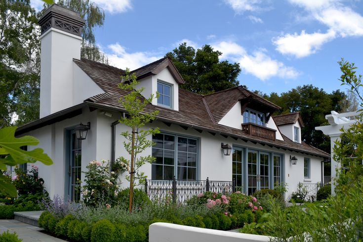 White house exterior traditional design ideas with blue trim chimney cap cottage dormer dormer for Exterior decorative trim for homes