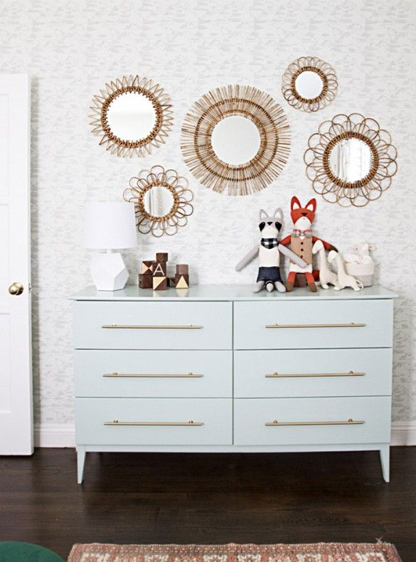 A coat of soft green paint and a set of brass bar pulls transformed IKEA's wooden Tarva dresser into something plain to something photogenic.