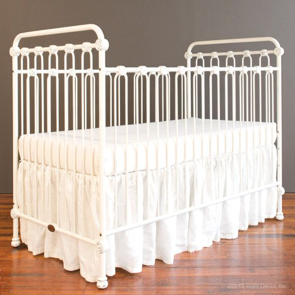 sweet cast iron crib in distressed white, vintage look with today's safety standards