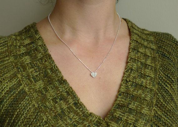 """This adorable necklace features a heart pendant with a knitted texture on the surface. Perfect for anyone who loves to knit just to pass on that cozy feeling of being wrapped up in a warm knitted sweater. A great everyday piece.  The pendant is approximately 1/2"""" wide and hangs on an 18"""" sterling silver faceted ball chain."""