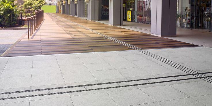YAU TONG – HONG KONG A #Coem project in the #FarEast: #outdoor tile #flooring in #Pietra #Vicentina #Gold and #Grey near the Yau Tong Station in #HongKong.