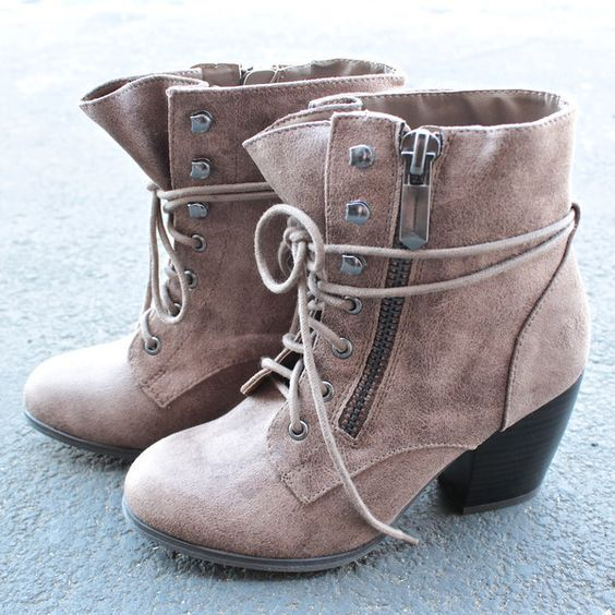 One of our customer's favorite is back! Stylish ankle boots that features a side zip, laced up front, and stacked heel. man made material imported color: taupe, cognac, or black Fits true to size ** Want to know more, click on the image.