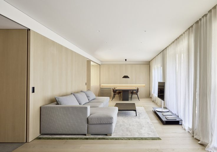 DM Apartment is a minimal apartment located in Barcelona, Spain, designed by Francesc Rifé Studio, that's divided into two main areas.