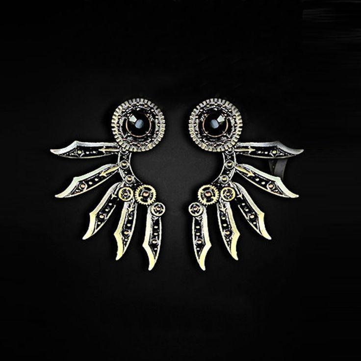 Steampunk stud earrings, they look like wings.. fun fact: wins are made out of sabers #jewelery #alternative #edgy www.attitudeholland.nl #original