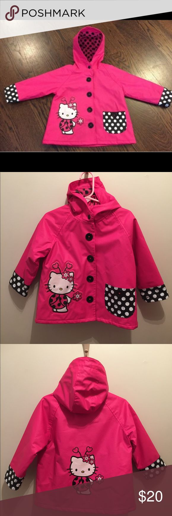 Cute raincoat Perfect for the hello kitty fan! Waterproof outer and warm inner lining. Hood and functional pocket in the front. The buttons are actually snaps for easy on/off. Western Chief Jackets & Coats