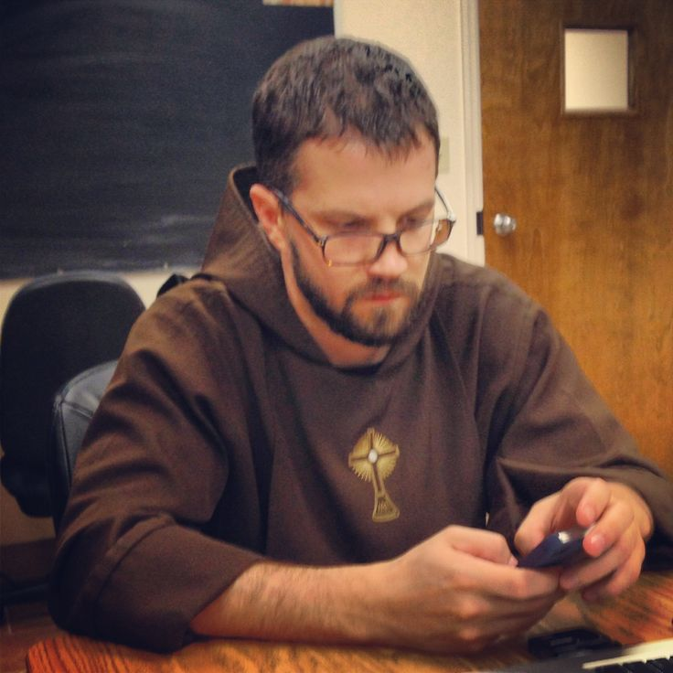 Fr. Paschal reaching out via iPhone