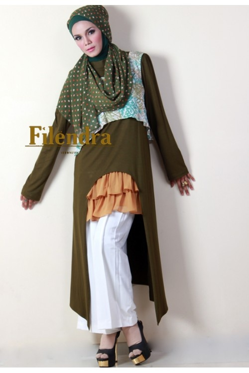Multiple Layers and colors including an unusual cut to long duster over ruffles and pants from Filendra