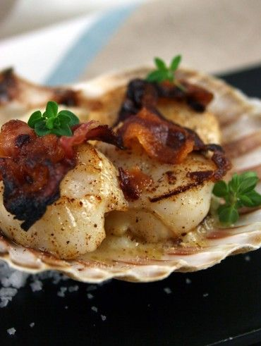 Seared scallops on a creamy artichoke purée and topped with crispy bacon... served on a Scallop Shell...Appetizer Recipe <3
