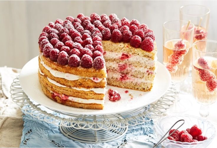 With three raspberry cream layers between a hazelnut flavoured torte topped with…