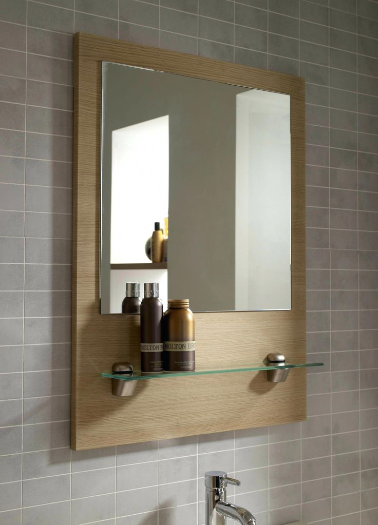 A large framed mirror is impressive and elegant. There are ...