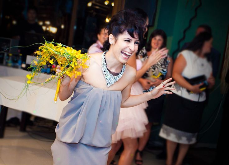 Alina Popa, flower designer at NO NO NO, catching her own bouquet at her sister's wedding