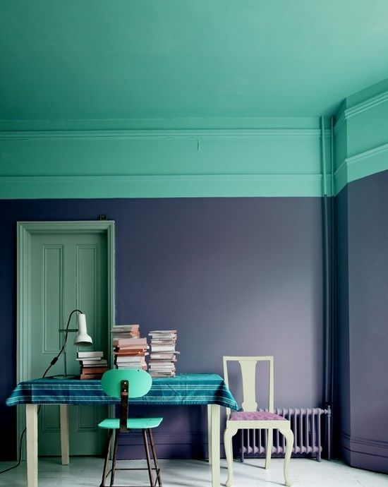 Paint your ceiling a vibrant color and bring it down the wall to create a border effect.