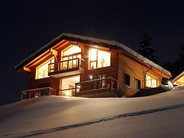 Chalet-style house in the night