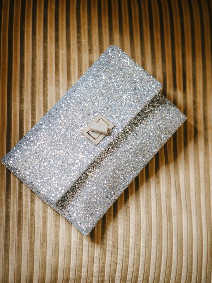 Sparkly Clutch by AnyaHindmarch.com - See the wedding on #SMP here: http://www.StyleMePretty.com/2014/04/18/classic-english-wedding-at-the-bodleian-library/  Photography: Stephanie Swann Weddings - stephanieswannweddings.co.uk