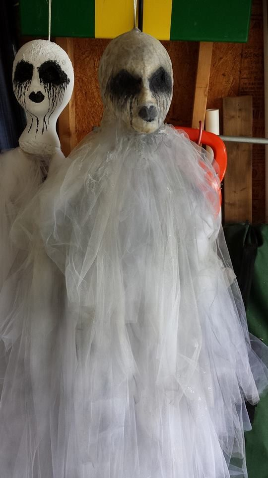 Easy DIY ghost using a styro foam head, a wire hanger and tulle.