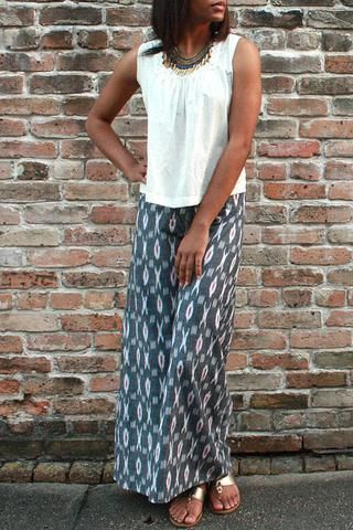 Description These super comfy and chic colorful spinnaker pants feature a flat front waistband in the front and an elastic waistband in the back with a side slit. The side slit allows the pants to flo