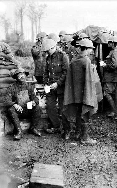 WWI, 5 Oct 1917; A YMCA stall at St Jean supplying hot drinks to walking wounded troops from the New Zealand Division of II Anzac Corps on the 5th October, the day after they captured the village of Grafenstafel during the Battle of Broodseinde. Detail. © IWM (Q 2973)