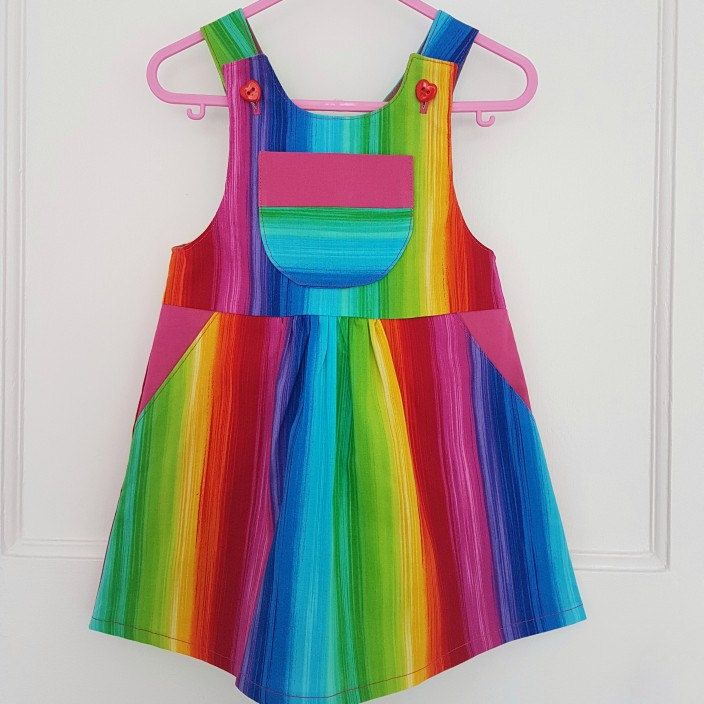 Stunning new rainbow dungaree dress. Perfect for making happy memories.